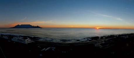 Table Mountain on the left, the sun setting over Robben Island on the right - two of South Africa's